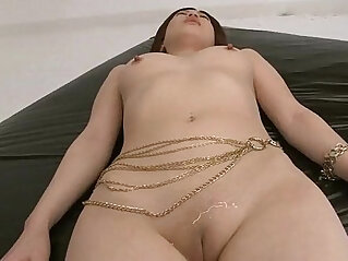 Horny guys oil up Rikos shaved pussy and finger it