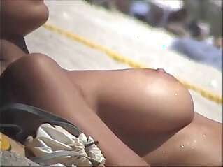 Debora Bello topless at the beach!