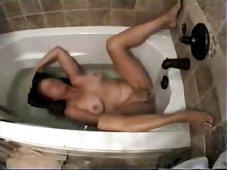 Hidden cam catches my horny mom masturbating in bath tube