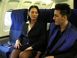 Brunette beauty wearing stewardess uniform gets face fucked on a plane