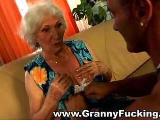 Mature granny fucked by a large cock