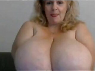 Granny with round huge natural boobs from