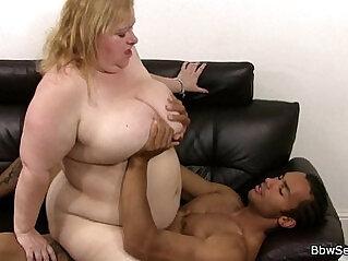 Busty plumper rides black cock
