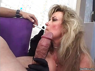 Sexy blonde mature smokes and sucks big black cock